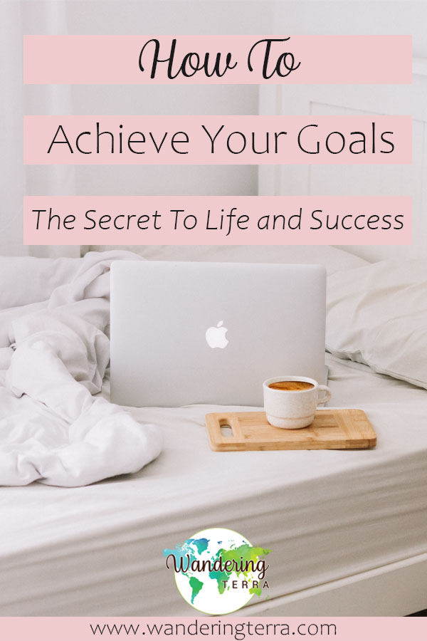 How to achieve your goals: enjoy the journey (the secret of life) - laptop and coffee sit on bed to achieve goals and live dream life in neutral room with white bedding and a white bed. Apple macbook