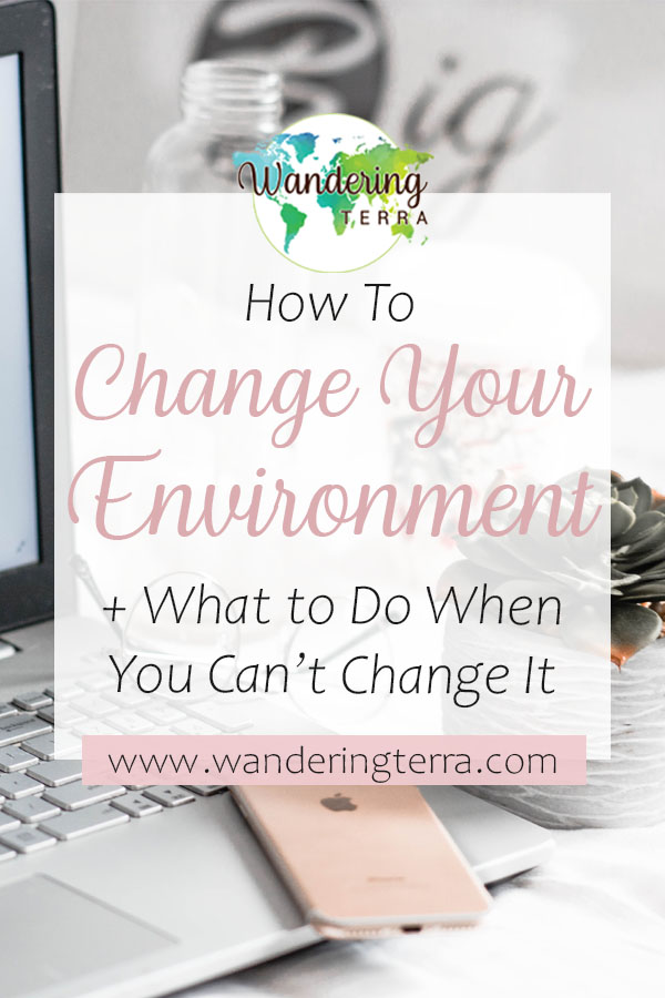 How to Change Your Environment (and What to Do When You Can't) pin for Pinterest with a gold iphone lying on a laptop keyboard with a coffee cup, water bottle and notepad for working in an environment