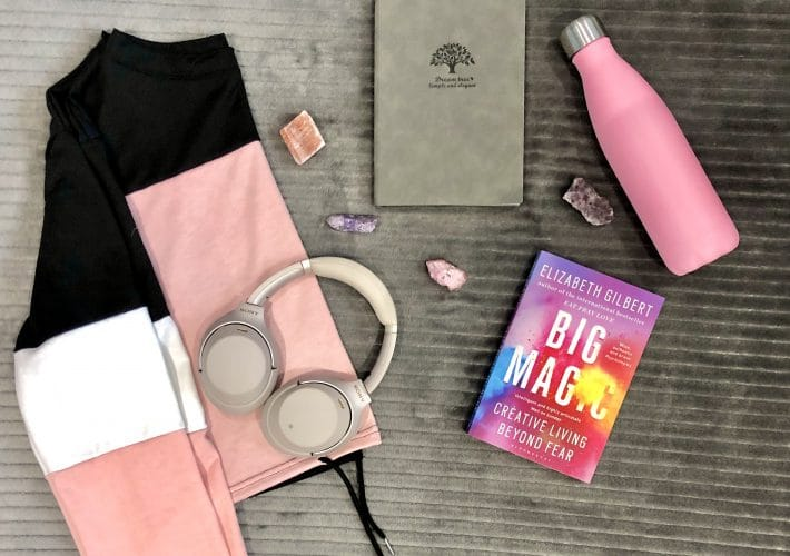Organise your life: My GYST routine and how to create your own - pink, black and white jumper, headphones, books, notepad, water bottle and crystals