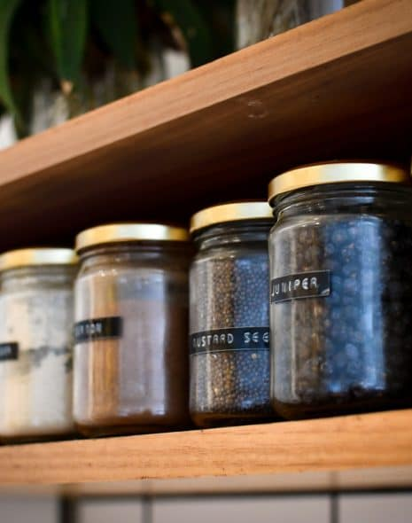 The ultimate spring cleaning checklist - labelled food jars on shelf in the pantry in the kitchen for storing food and produce