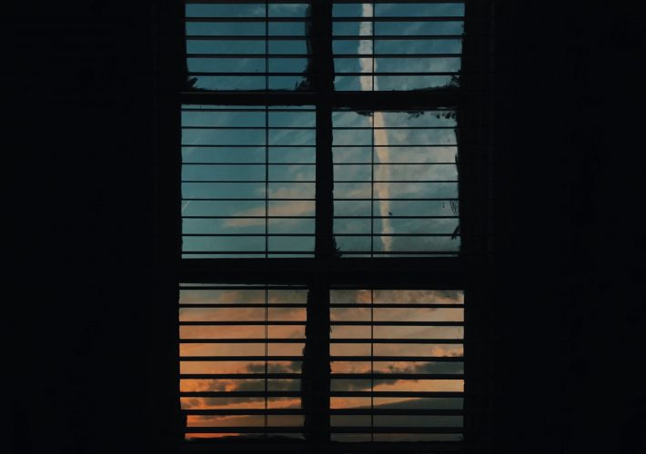 Create a relaxing night routine: wellness and hobby inspired. Window looking out to sunset in early evening night as part of a relaxing night routine