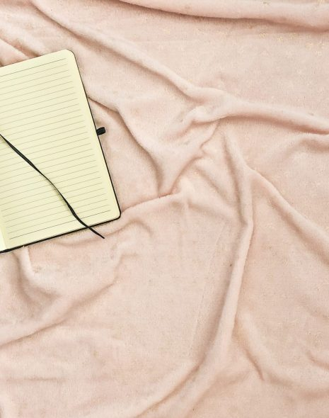 How To Write A Journal: What Happened When I Started Journaling Everyday - open notebook lies on pink and gold star background with a pen ready to journal and start journalling