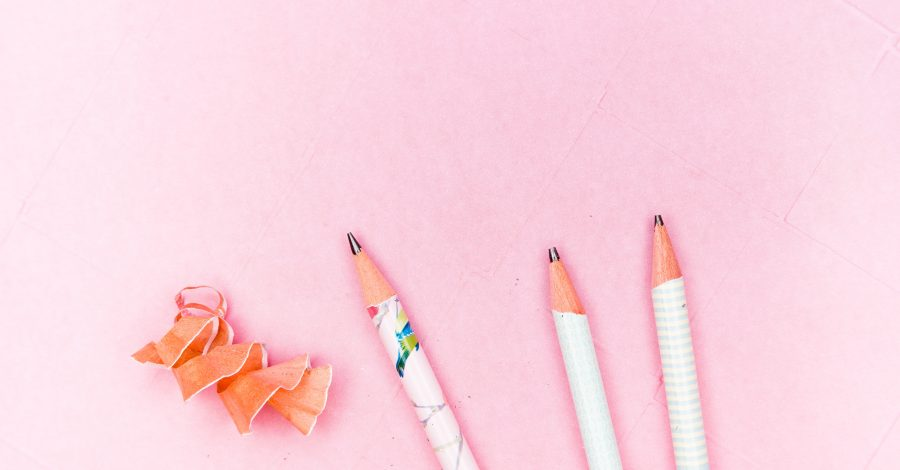 Why are hobbies so important? 8 Reasons You Should Start A New Hobby -- three pencils and some pencil shavings lie on a pink background ready to draw as a hobby