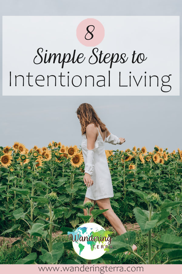 Simplify Your Life: 11 Steps to Intentional Living - girl walks in white flowing dress in field of sunflowers pin for pinterest