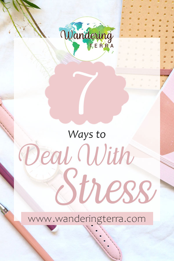 How to Avoid Burnout: 7 Ways to Manage Stress pin for Pinterest: watch, pens, notebooks and work lay on table to help work and balance work life balance