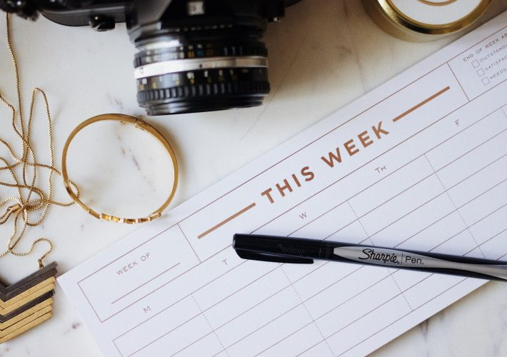 How to Set Goals in Life: 3 Ways to Design Your Goals - pen, agenda camera and goal-setting template lie on table ready for how to set goals in life