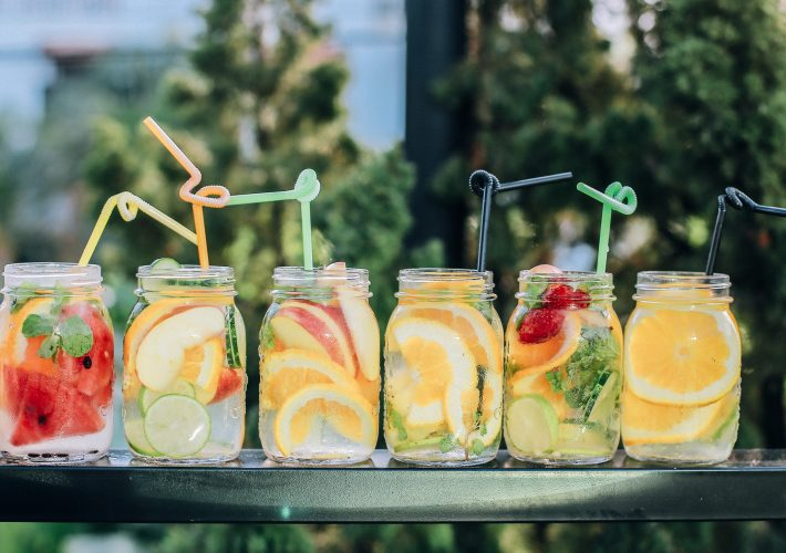 12 Ideas for Your Summer Bucket List 2020 - a row of six mason jar, kilner jars, stand on a table filed