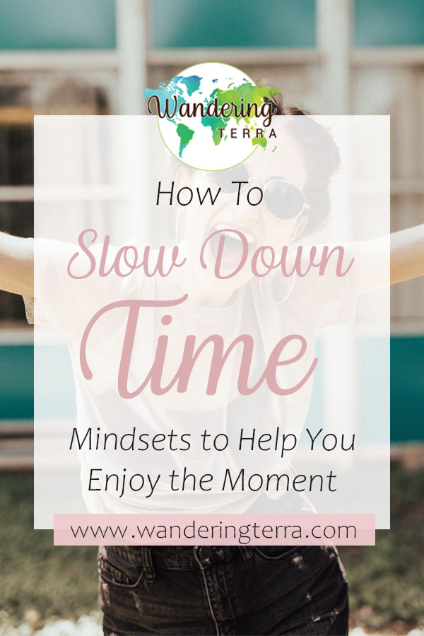 How to Slow Down Time: Simple Mindsets to Enjoy the Moment pin design for pinterest with girl smiling with sunglasses at the camera with open arms outside in the sun
