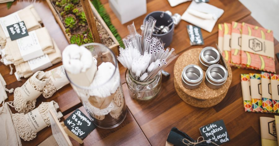 How to be more eco-friendly: 58 Simple Habits - wooden kitchen products and eco friendly alternatives lay on a table in a shop for people to buy to be more sustainable and to be more eco friendly