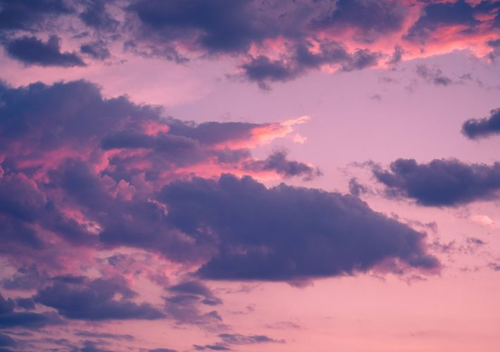 Things To Do in the Evening: 44 Ideas for When You're Bored Inside - evening light in the sky illuminating the clouds pink, purple and blue as a pretty sunset in the evening and things to do in the evening or things to do at night
