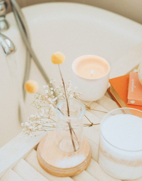 Simple, Good Daily Habits for When You're Busy - cup of tea, flowers and candle sit on tray abouth bath run for relaxing evening time everyday