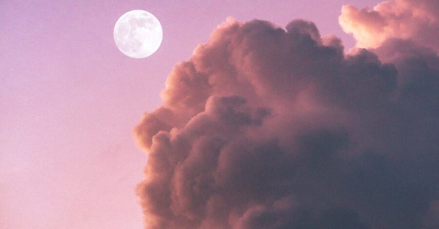 What is your moon sign? A full moon in a pink sky with purple and red clouds